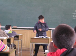 Chinese student performing for classmates